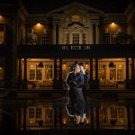 Bride and Groom reflection outside a hall