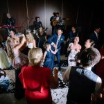 Guests and the bridal party dancing