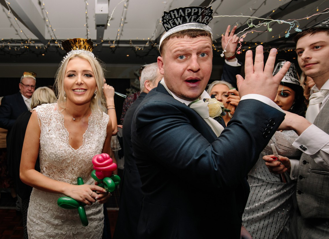Photograph of the Bride and groom celebrate New Years Eve at their wedding
