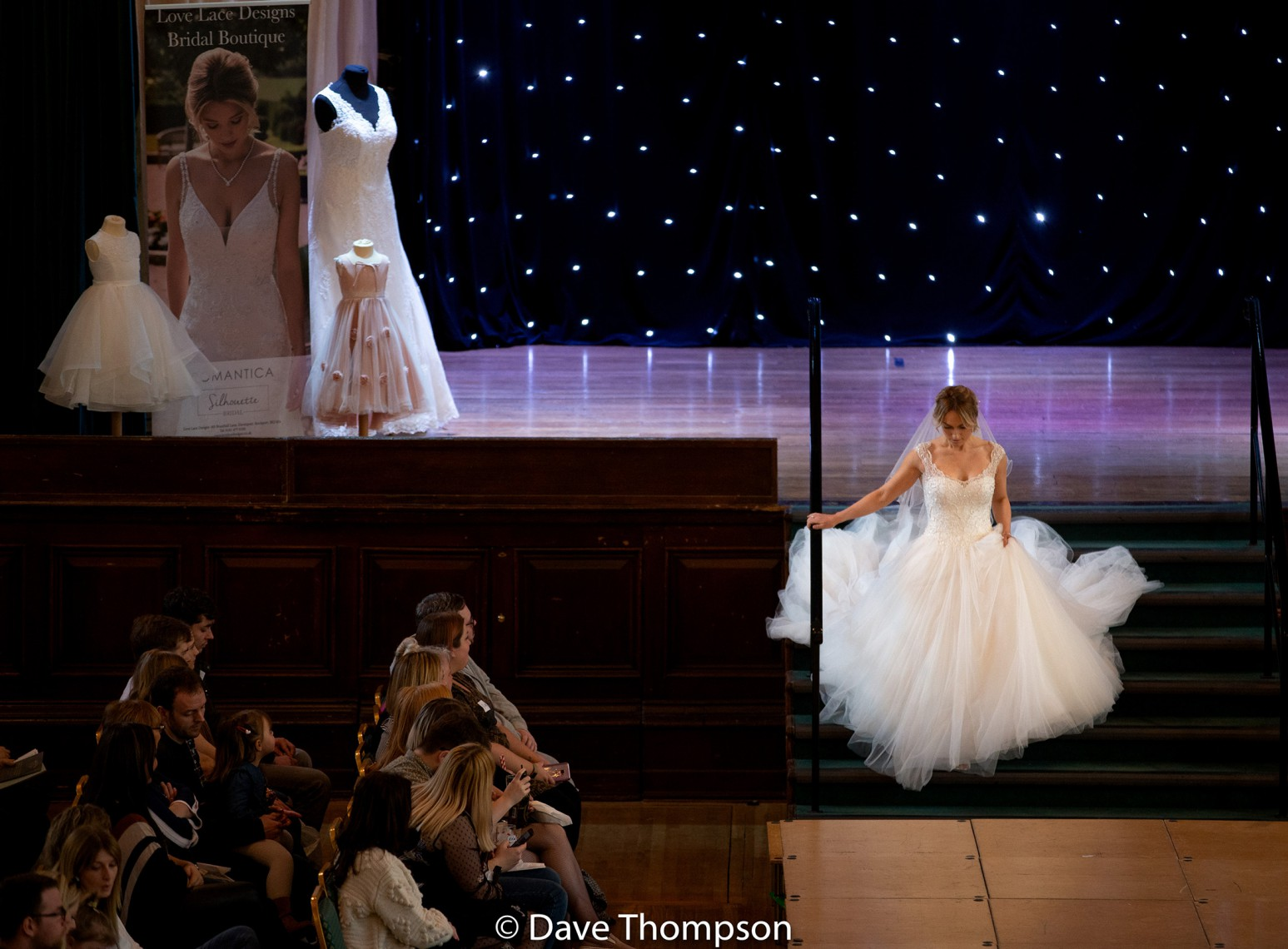 Bride walks down the stairs at a Stockpot Town Hall Wedding Fayre Catwalk Show