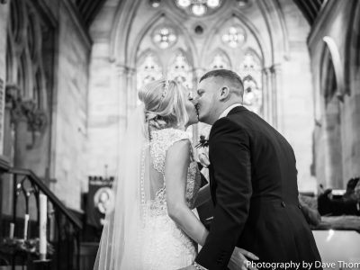 First kiss in church for the bride and groom