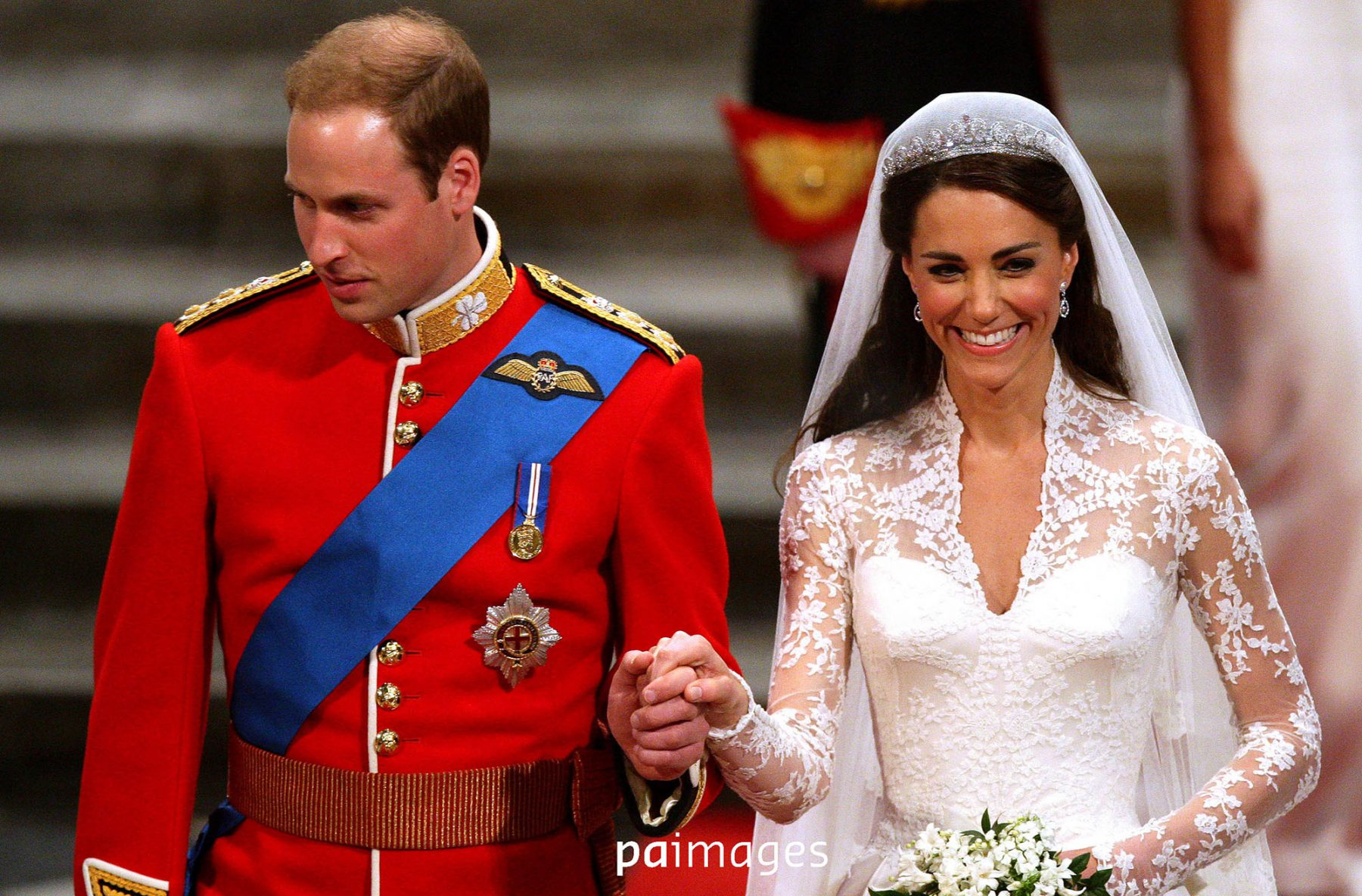 Prince William and Kate Middleton walking up the aisle together in Westminster Abbey