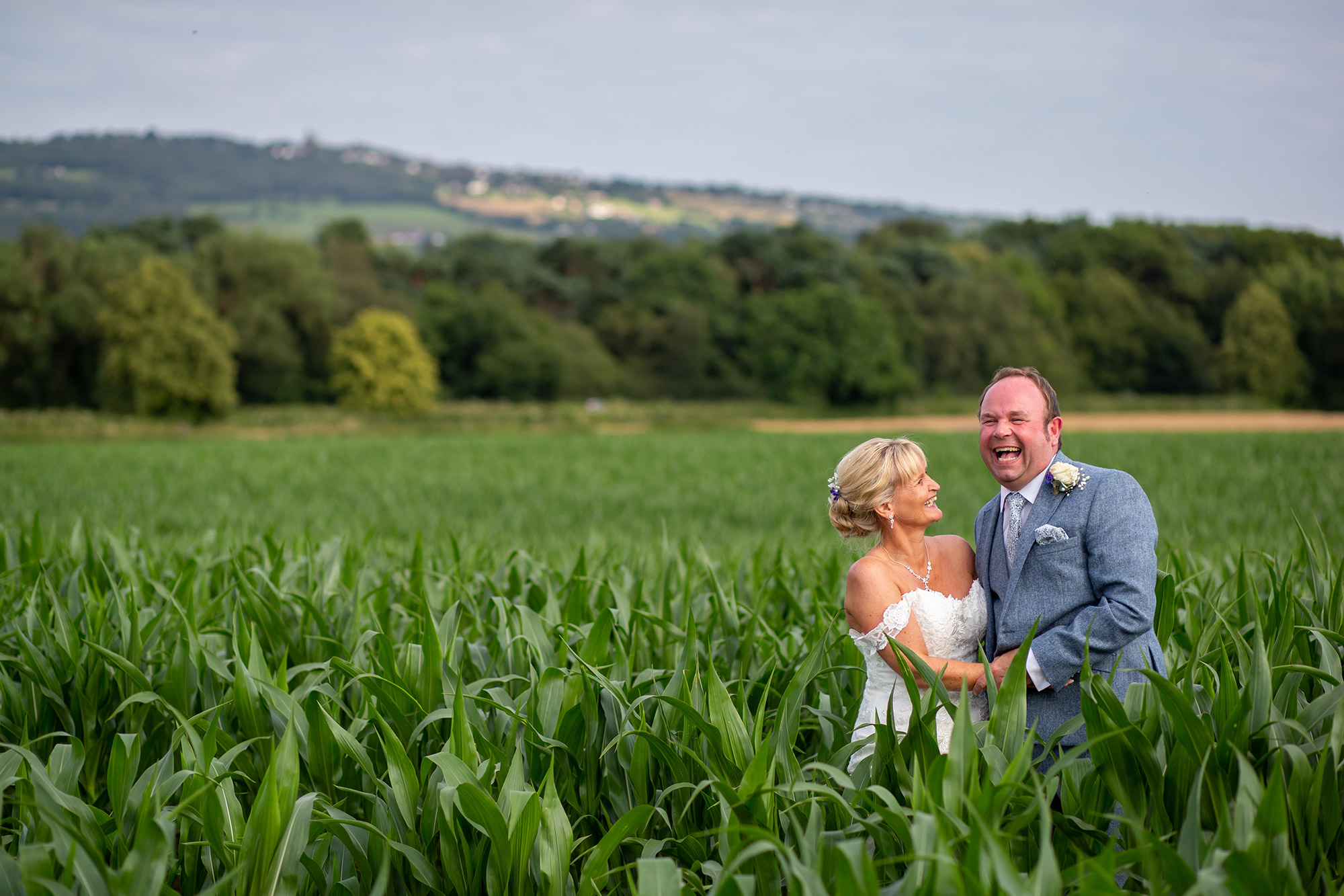 The bride and groom in a cornfield