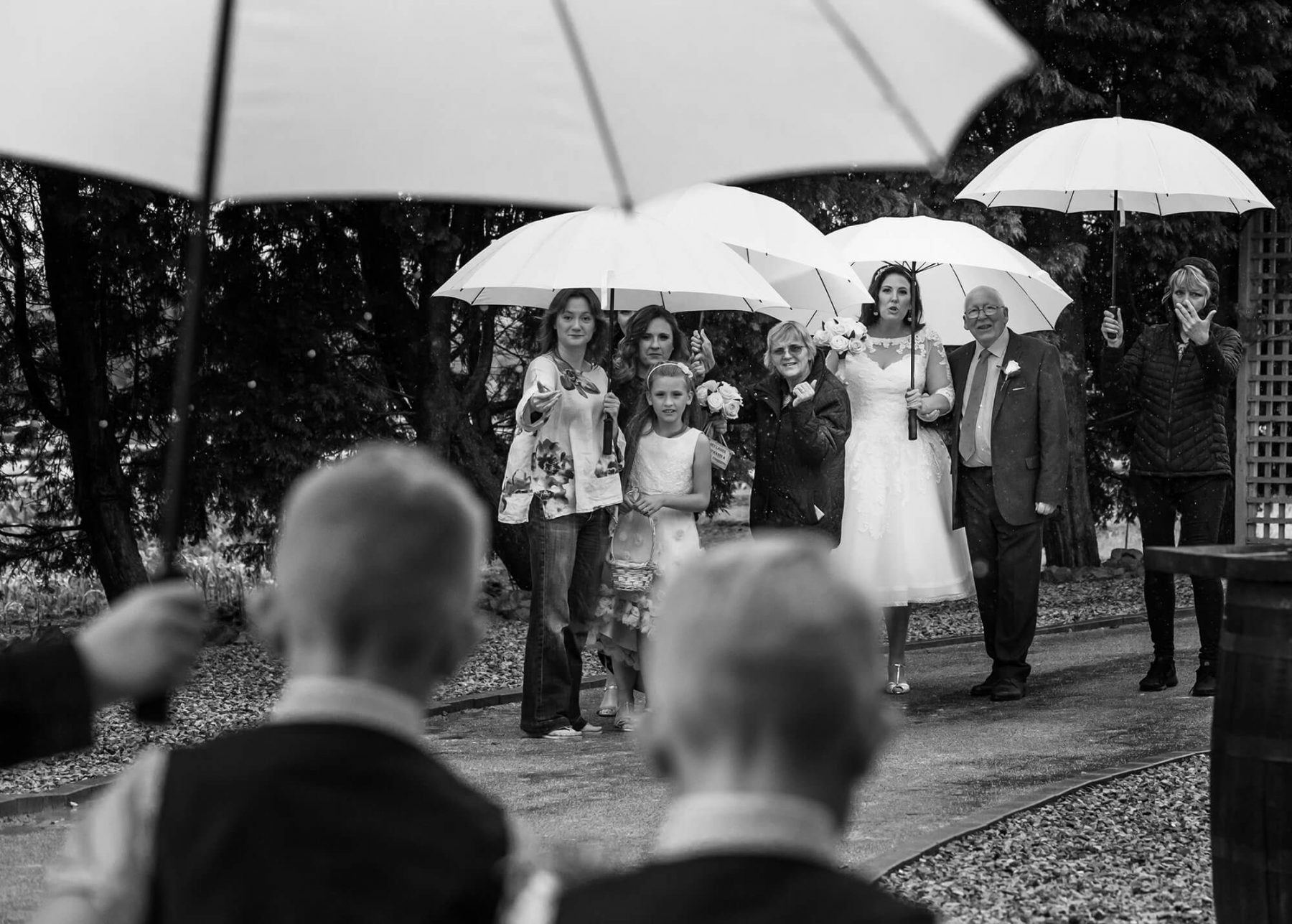 The bridal party arrive in the rain