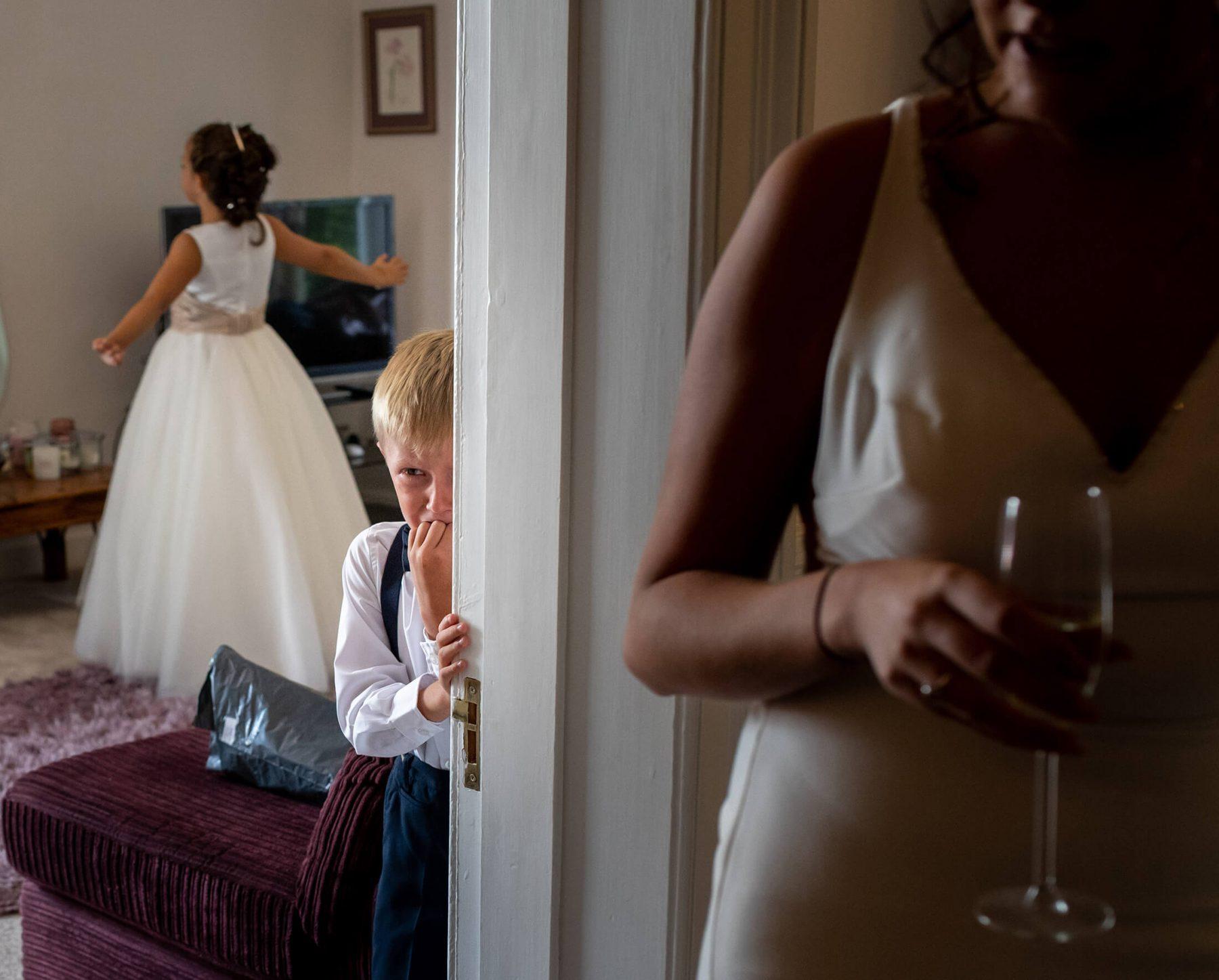 A young boy cries during bridal prep.