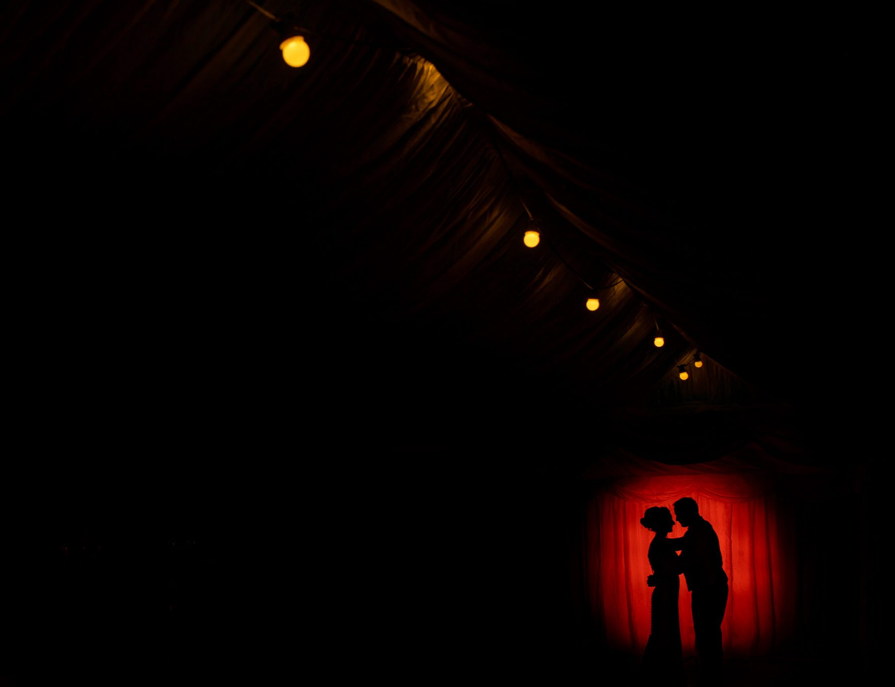 A bride and groom portrait using of camera flash at Nunsmere Hall.