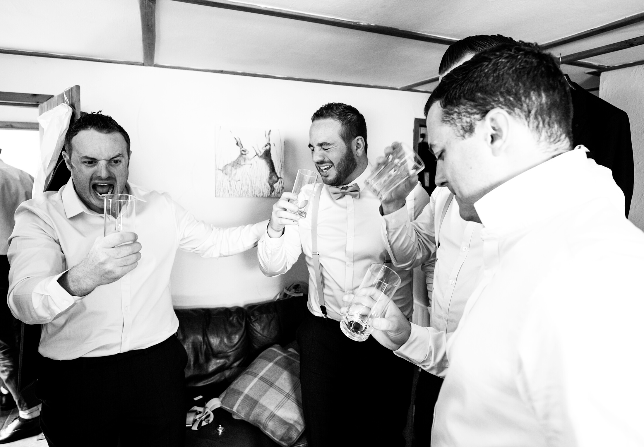 The groom and his groomsmen with a pre wedding drink