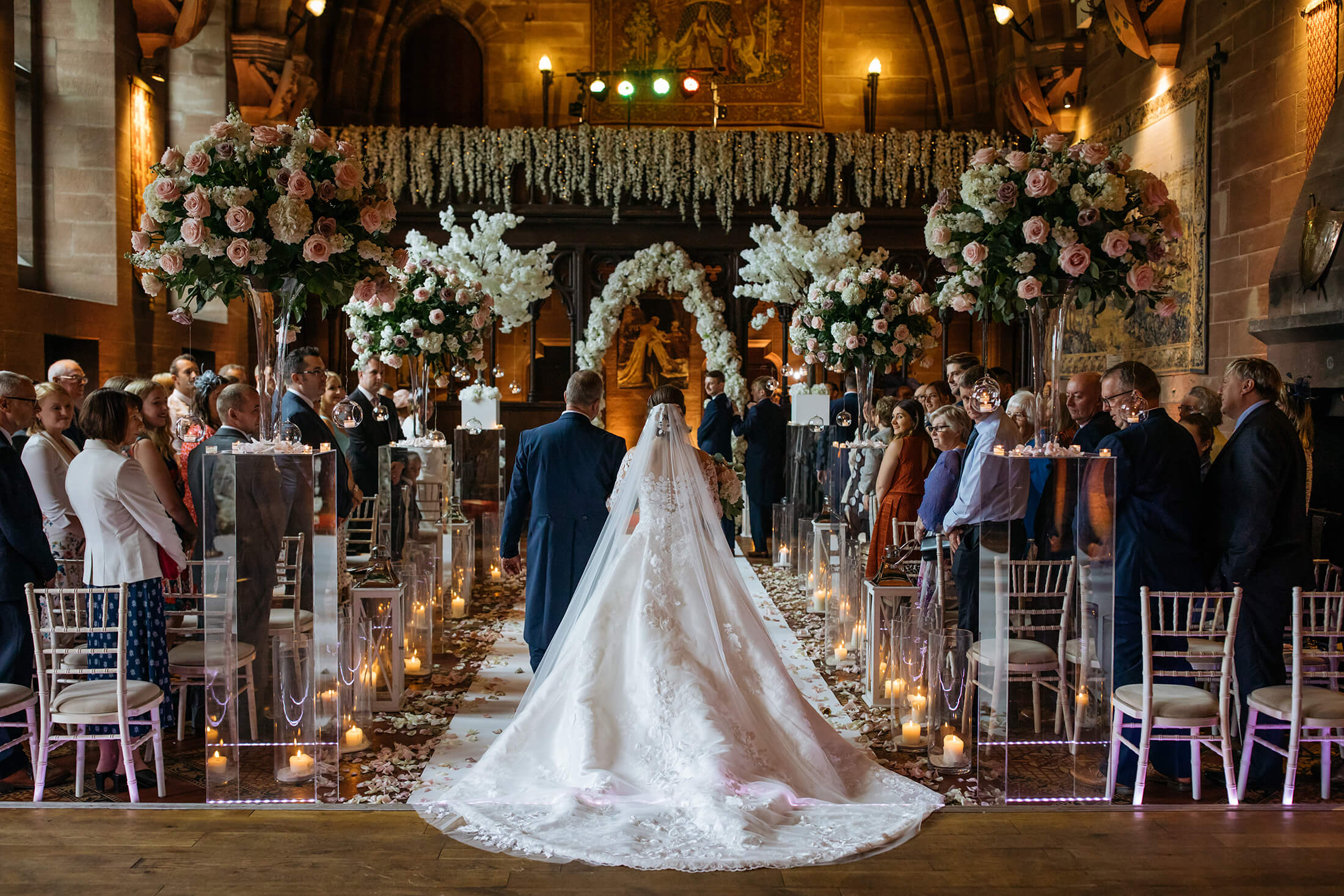 A father walks his daughter down the aisle at Peckforton Castle