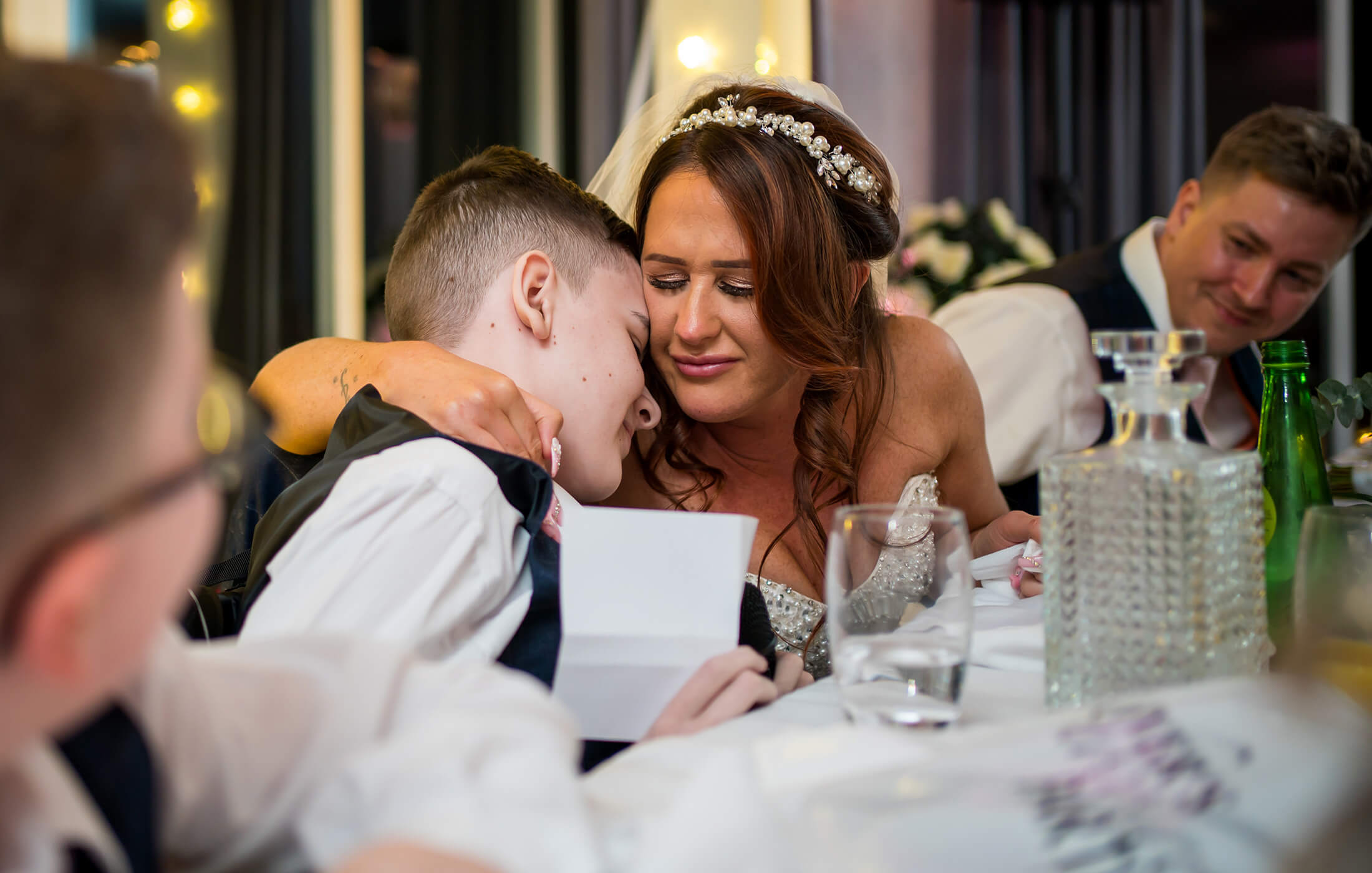 Hollin Hall Hotel Wedding Photographer - The bride hugs her son after his speech