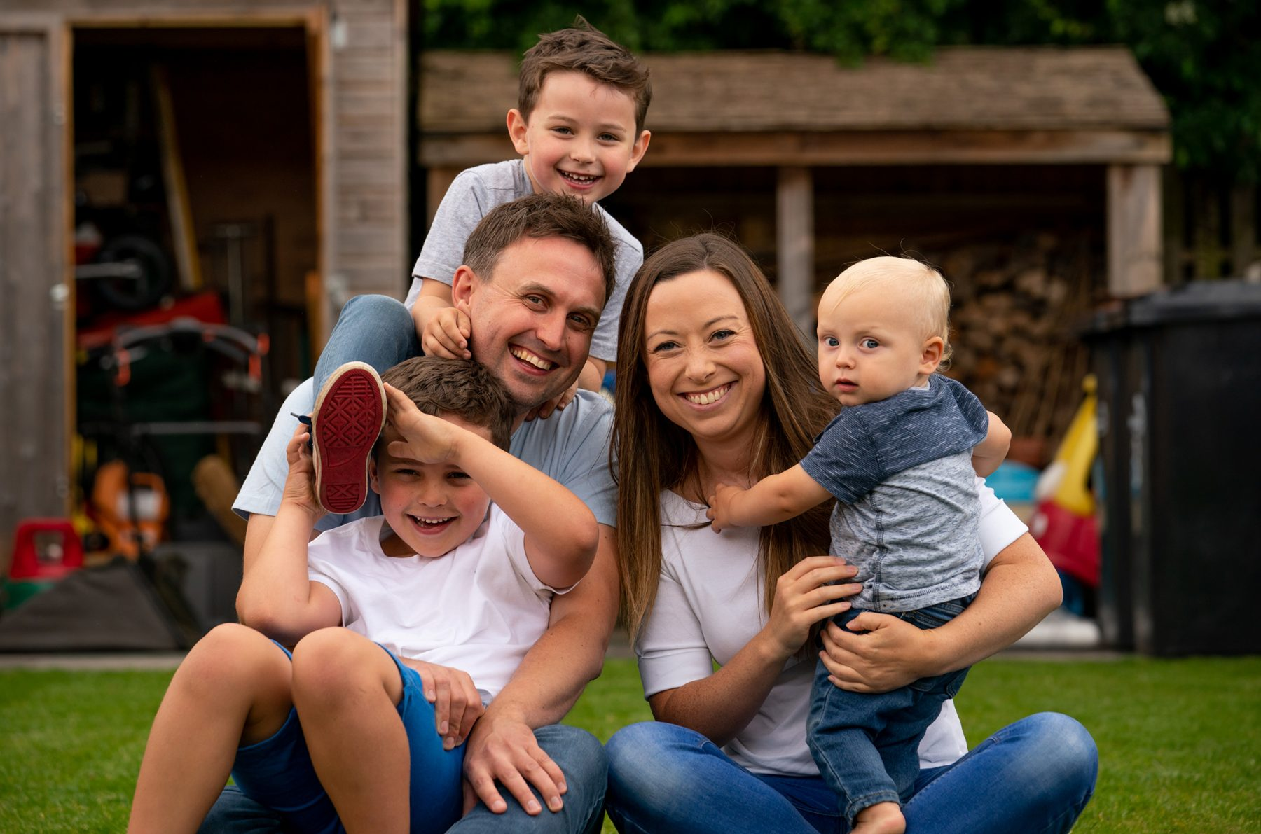 A family from Alsager in Cheshire have their photograph taken in their back garden