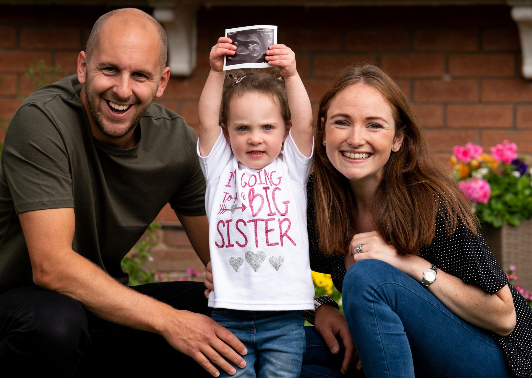 A Stockport Family have their photograph taken on their doorstep