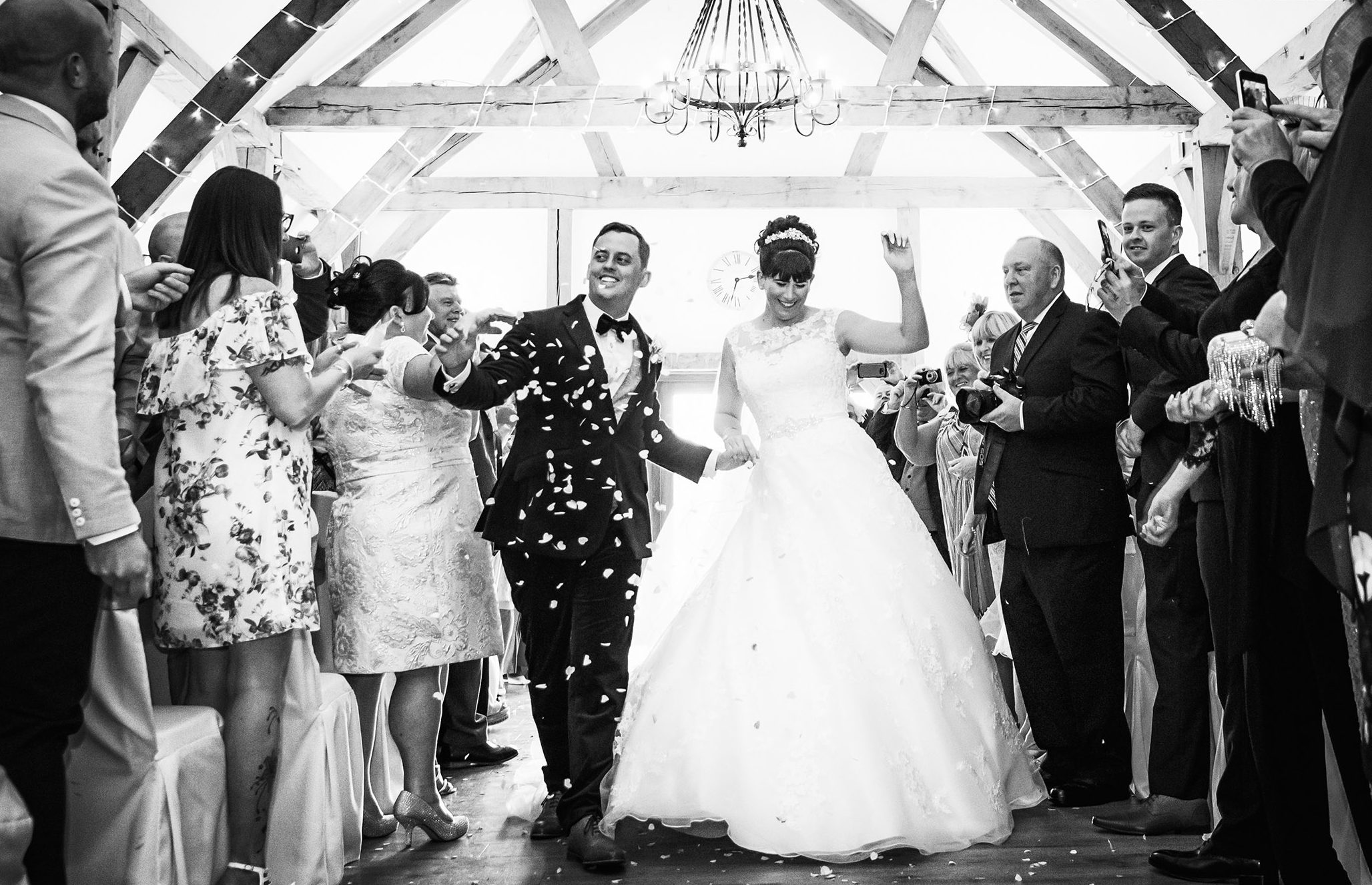 The bride and groom walk down the aisle after their wedding at Sandhole Oak Barn, Cheshire