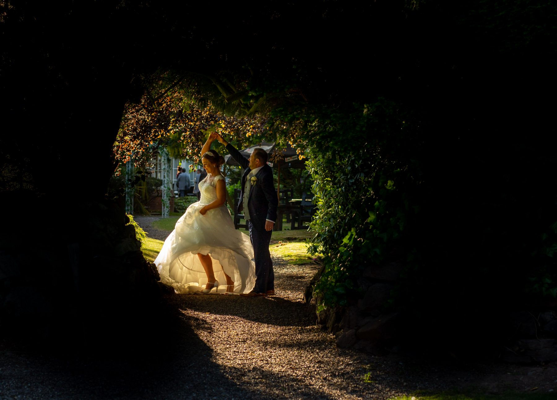 A bride and groom dance in the gardens at Mere Court Hotel
