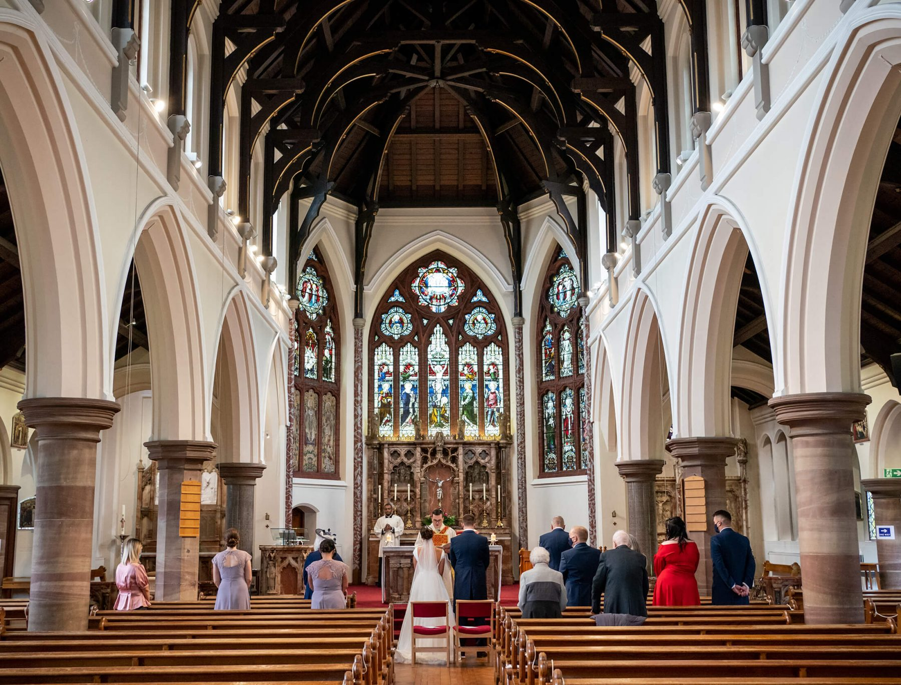 Wedding in Altrincham, Manchester and the guests inside the church while the bride and groom get married
