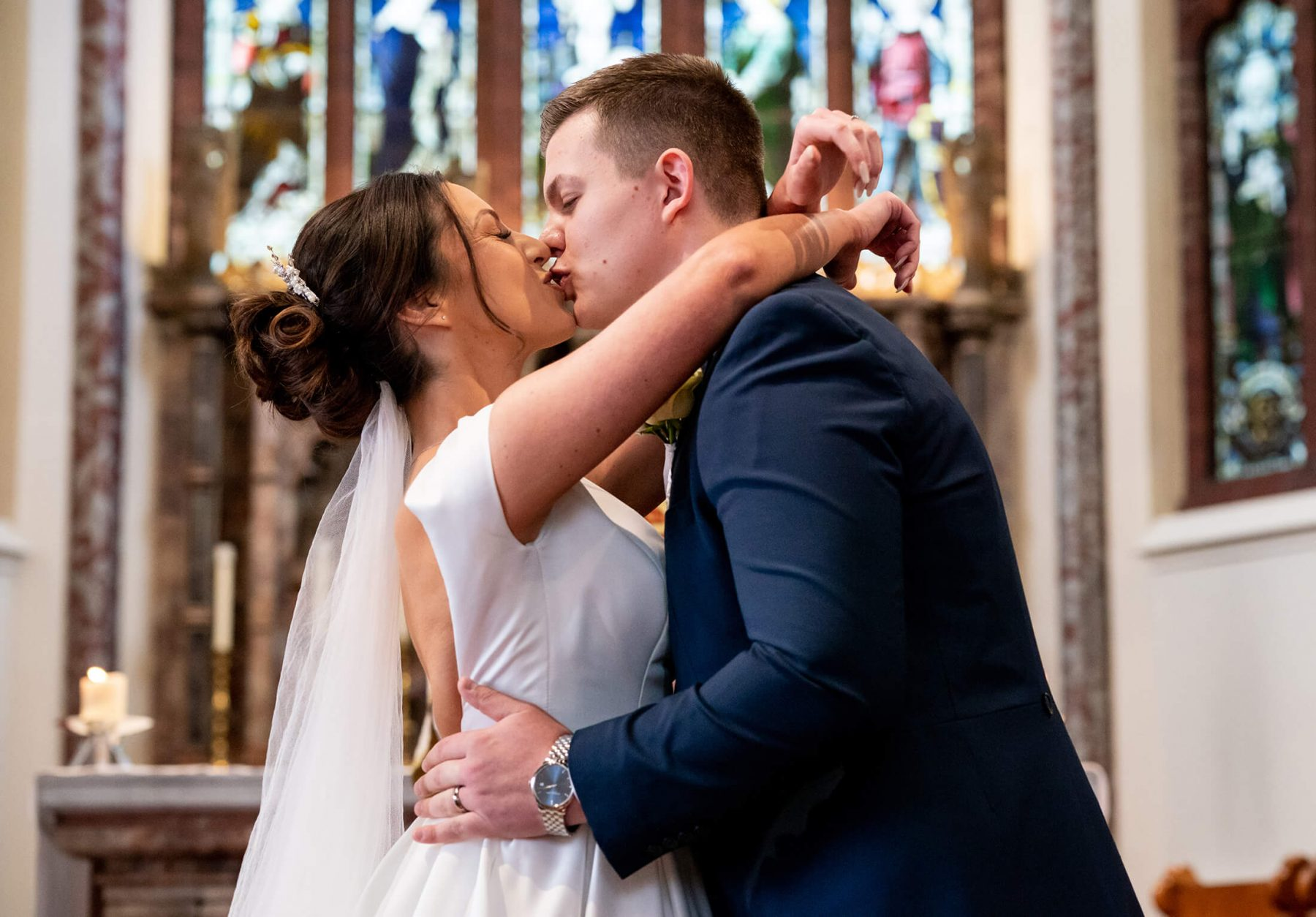Bride and groom kissing in the church after getting married