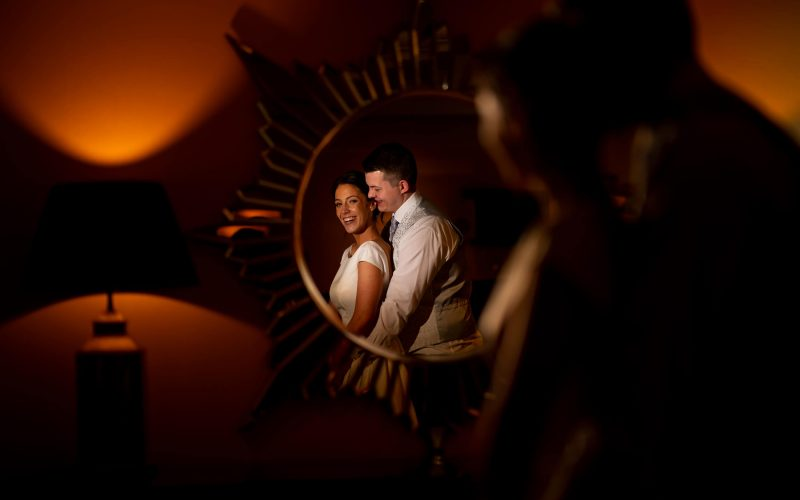 The bride and groom at their Manchester wedding in the reflection of a mirror