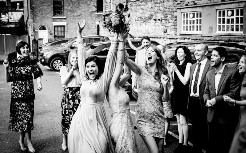 Guests catch the brides boquet at a wedding in Nantwich, Cheshire.