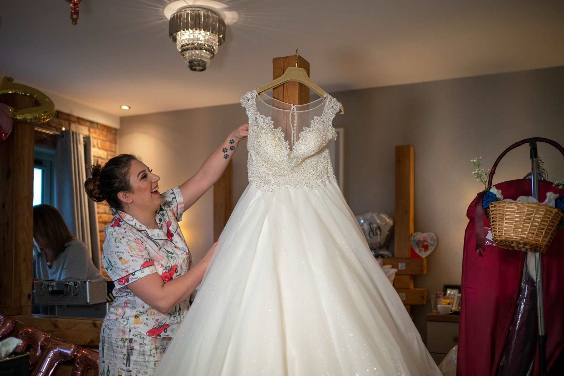 A bride hangs her dress up before her Cock O'Barton Wedding
