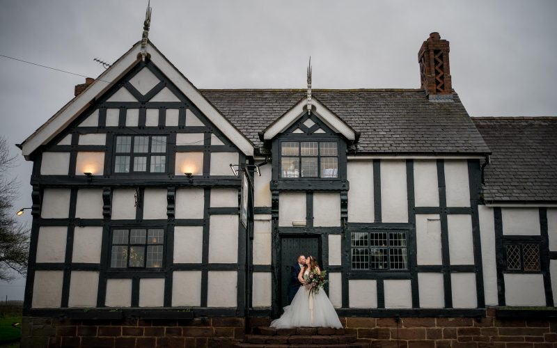 A picture of the bride and groom outside the front of the Cock O'Barton