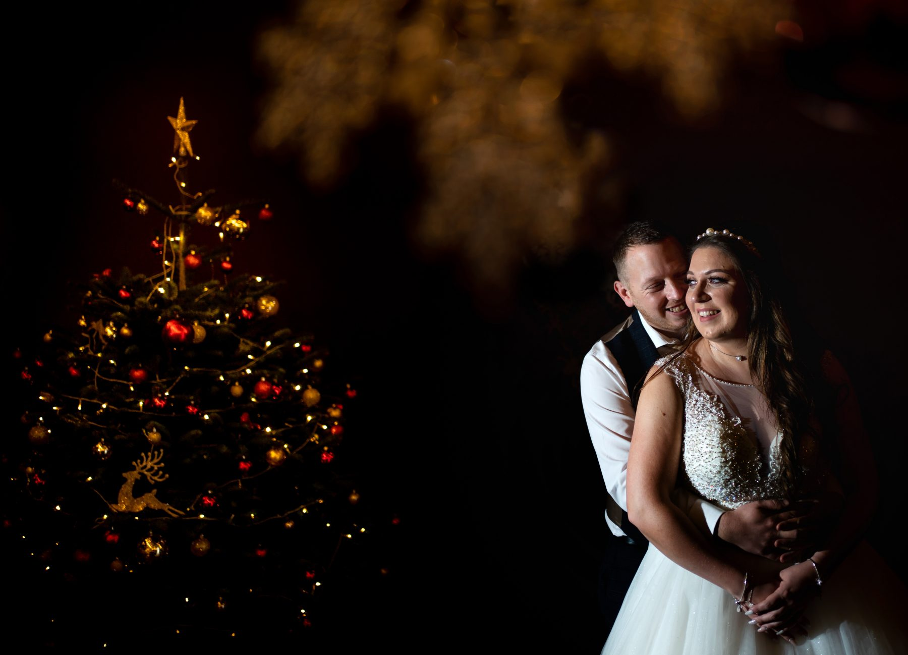 A creative off camera flash photograph of the happy couple