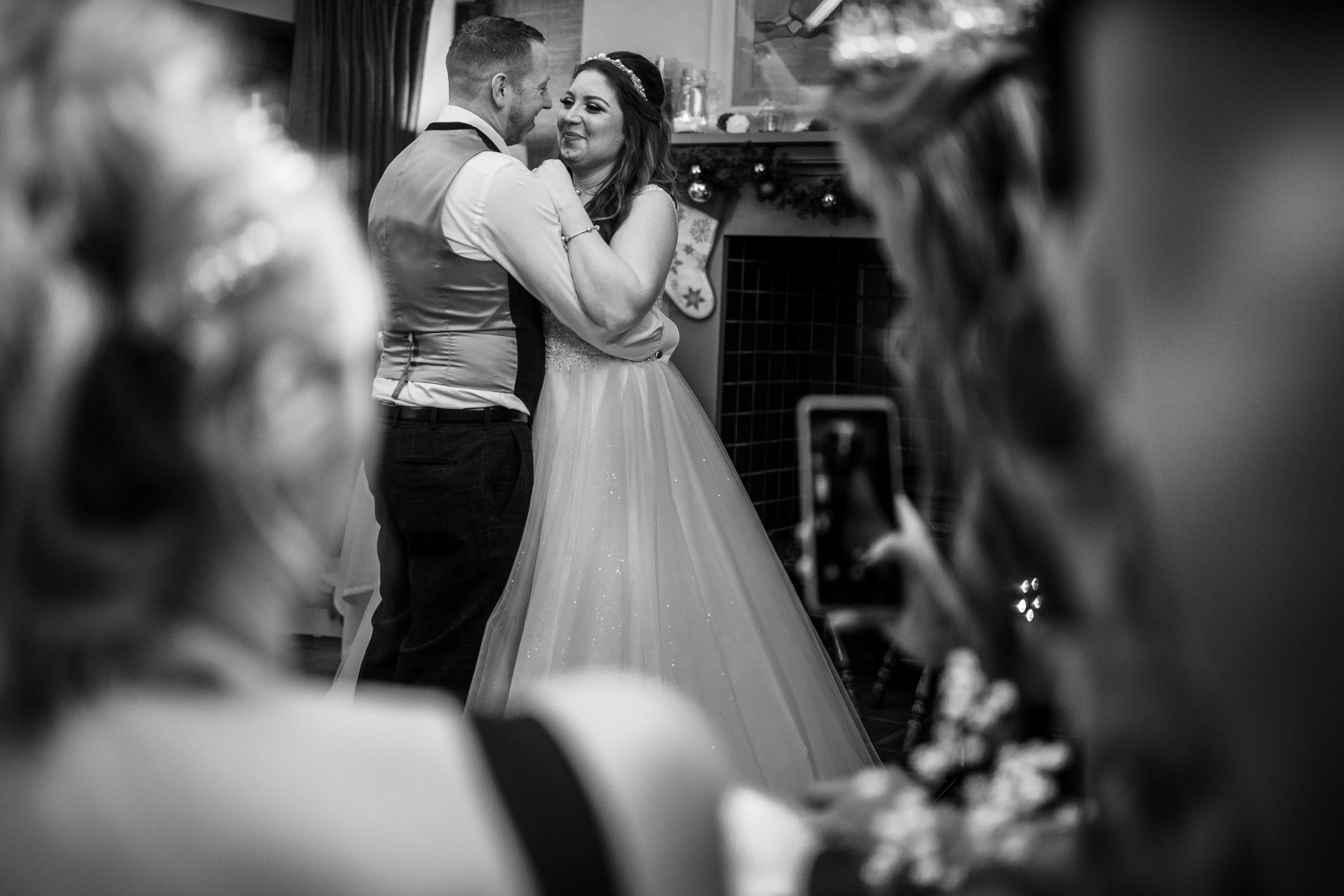 The bride and groom during thier first dance, in black and white