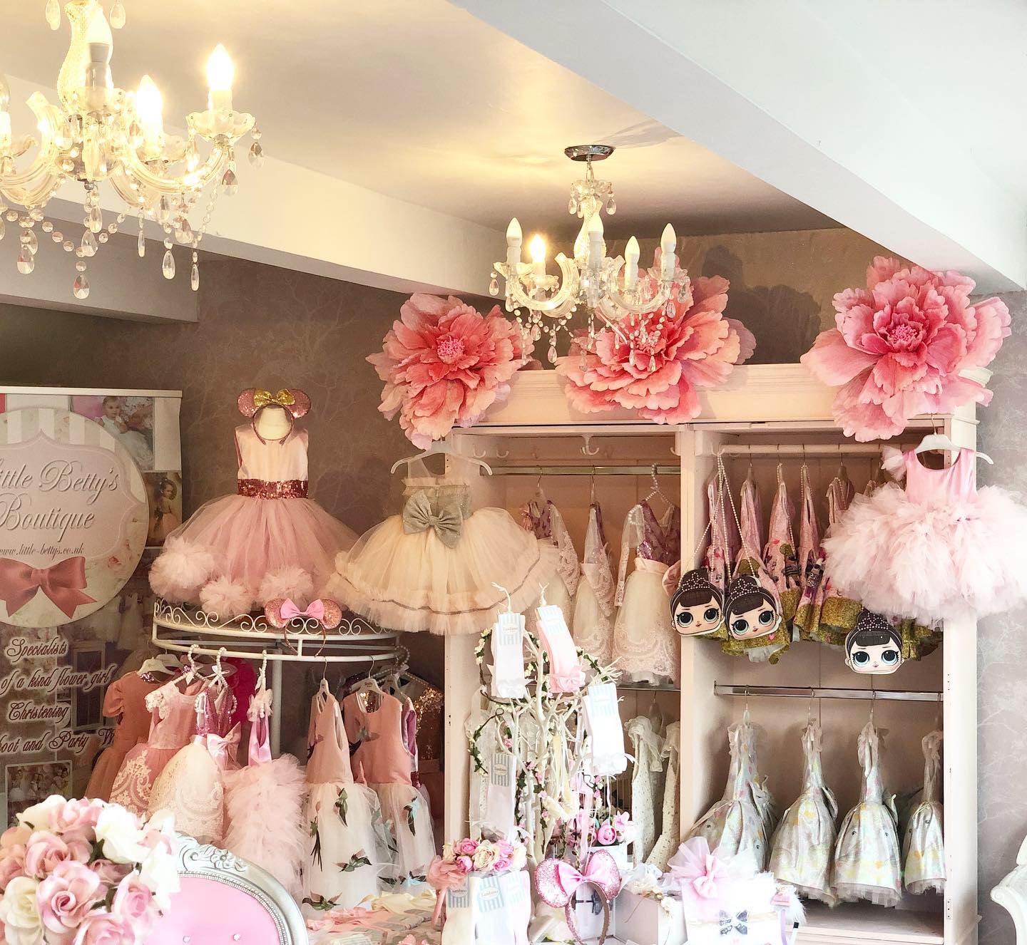 Dresses for flower girls on dirplay inside Little Betty's boutique in Stockport