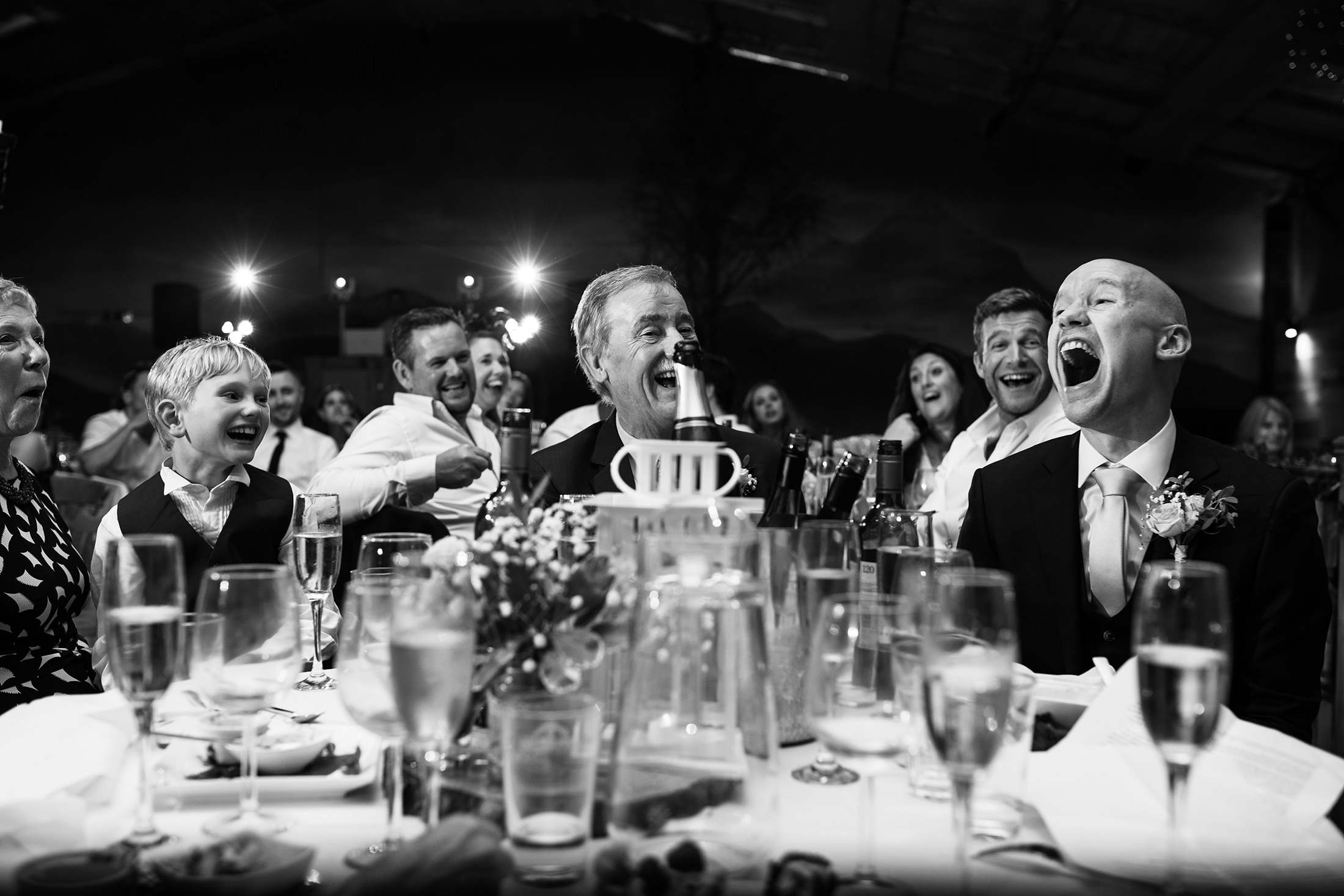 The groom and his family laugh during the speeches