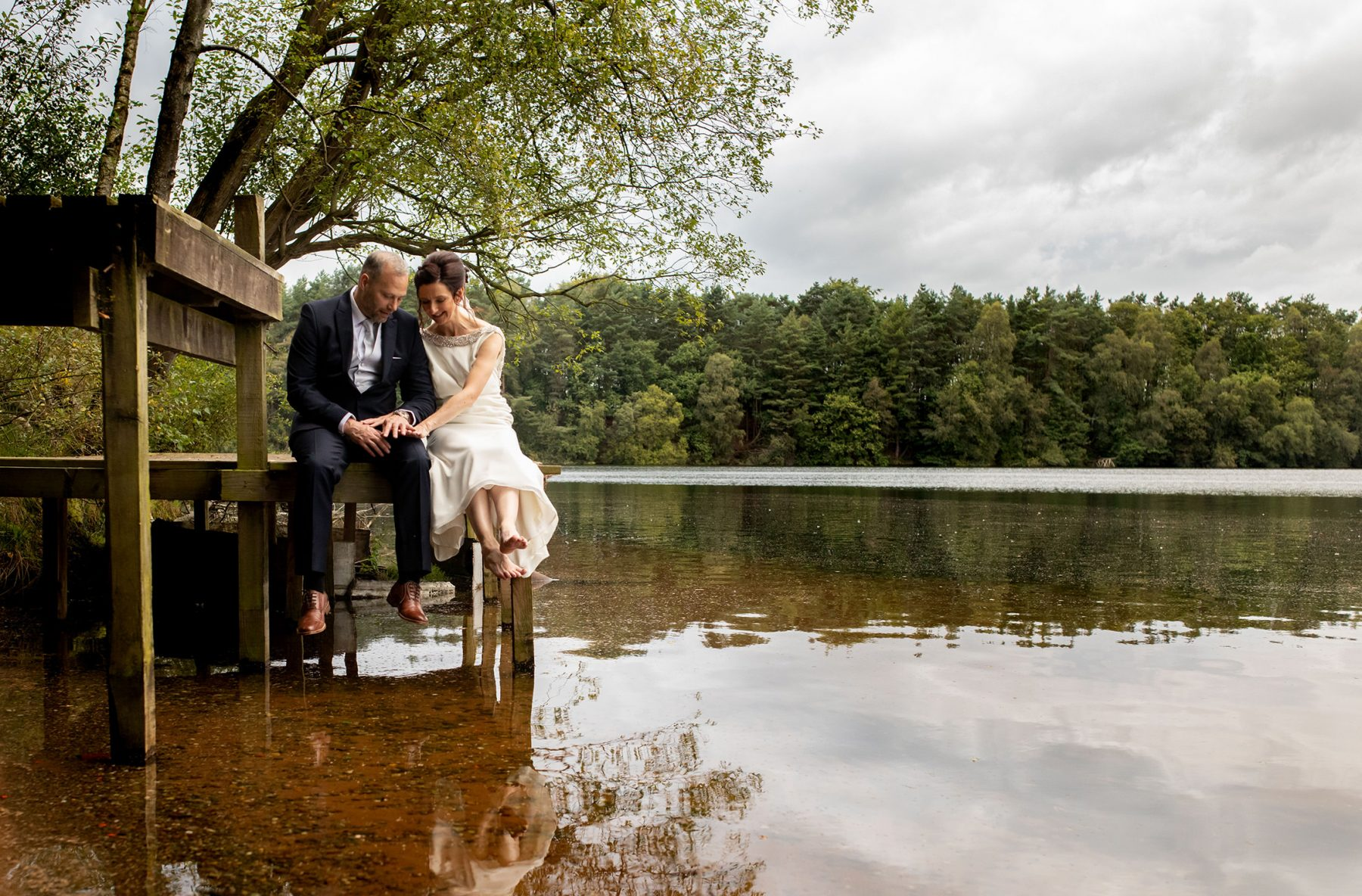 Down by Nunsmere Lake, the bride and groom have time together
