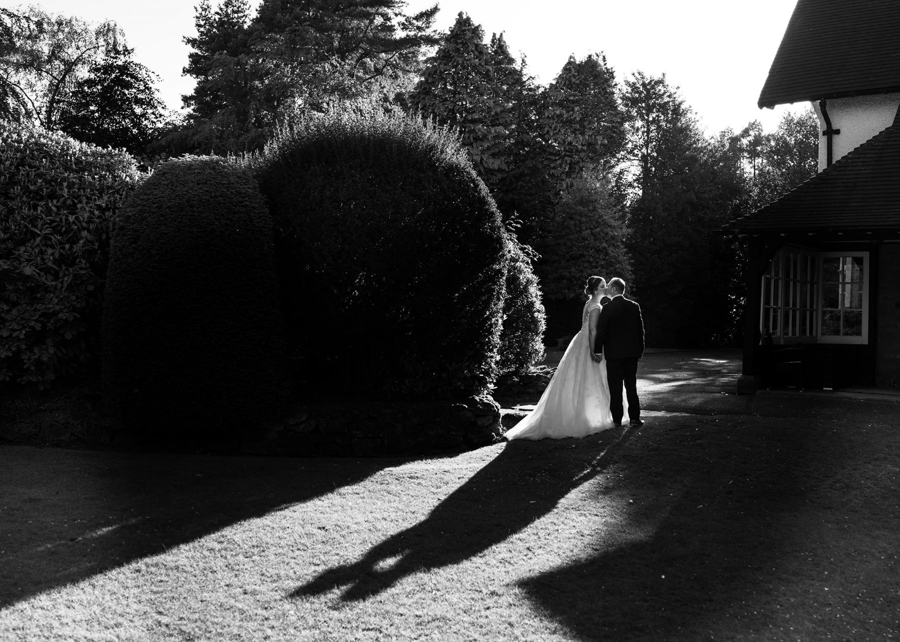Shadows from teh bride and groom created by the sun