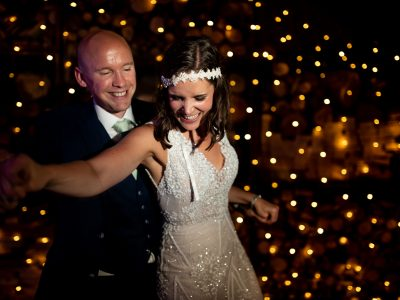A bride and groom enjoy their first dance.
